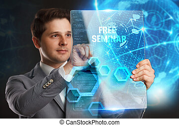 Business, Technology, Internet and network concept. Young businessman showing a word in a virtual tablet of the future: Free seminar