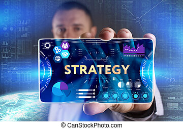 Business, Technology, Internet and network concept. Young businessman showing a word in a virtual tablet of the future: Strategy