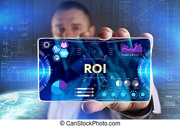 Business, Technology, Internet and network concept. Young businessman showing a word in a virtual tablet of the future: ROI