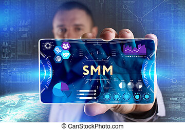 Business, Technology, Internet and network concept. Young businessman showing a word in a virtual tablet of the future: SMM