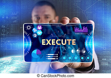 Business, Technology, Internet and network concept. Young businessman showing a word in a virtual tablet of the future: Execute