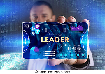 Business, Technology, Internet and network concept. Young businessman showing a word in a virtual tablet of the future: Leader