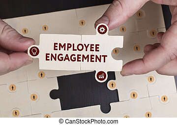 Business, Technology, Internet and network concept. Young businessman shows the word: Employee engagement