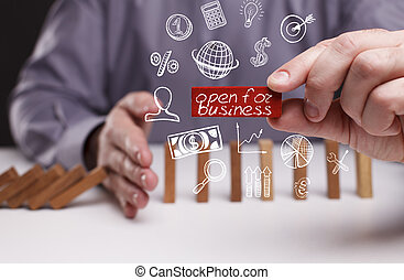 Business, Technology, Internet and network concept. Young businessman shows the word: open for business