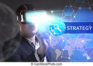 Business, Technology, Internet and network concept. Young businessman working in virtual reality glasses sees the inscription: Strategy