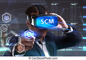 Business, Technology, Internet and network concept. Young businessman working in virtual reality glasses sees the inscription: SCM