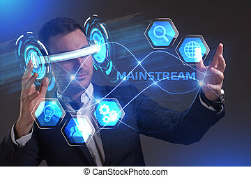 Business, Technology, Internet and network concept. Young businessman working in virtual reality glasses sees the inscription: Mainstream