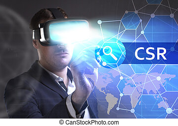 Business, Technology, Internet and network concept. Young businessman working in virtual reality glasses sees the inscription: CSR