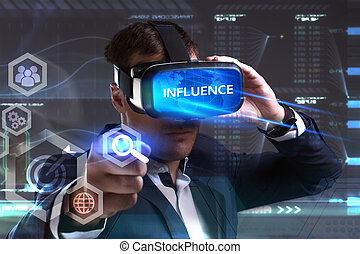 Business, Technology, Internet and network concept. Young businessman working in virtual reality glasses sees the inscription: Influence