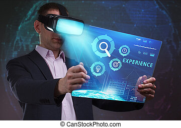 Business, Technology, Internet and network concept. Young businessman working in virtual reality glasses sees the inscription: Experience