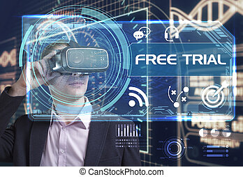 Business, Technology, Internet and network concept. Young businessman working in virtual reality glasses sees the inscription: free trial