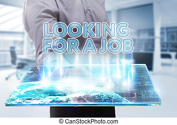 Business, Technology, Internet and network concept. Young businessman working on a tablet of the future, he sees the inscription: looking for a job
