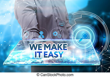 Business, Technology, Internet and network concept. Young businessman working on a tablet of the future, he sees the inscription: we make it easy