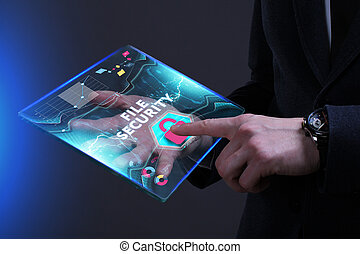 Business, Technology, Internet and network concept. Young businessman working on a virtual screen of the future and sees the inscription: File security