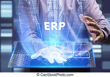 Business, Technology, Internet and network concept. Young businessman working on a virtual screen of the future and sees the inscription: ERP
