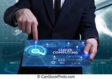 Business, Technology, Internet and network concept. Young businessman working on a virtual screen of the future and sees the inscription: Cloud computing