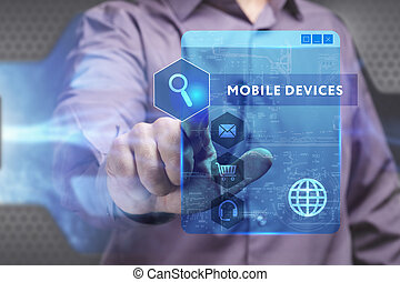 Business, Technology, Internet and network concept. Young businessman working on a virtual screen of the future and sees the inscription: Mobile devices