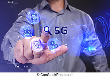 Business, Technology, Internet and network concept. Young businessman working on a virtual screen of the future and sees the inscription: 5G