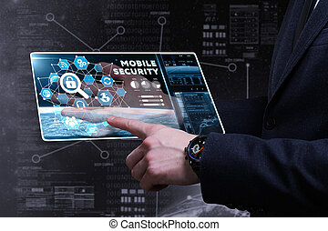 Business, Technology, Internet and network concept. Young businessman working on a virtual screen of the future and sees the inscription: mobile security