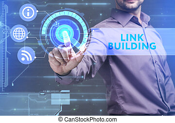 Business, Technology, Internet and network concept. Young businessman working on a virtual screen of the future and sees the inscription: Link building