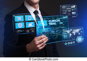Business, Technology, Internet and network concept. Young businessman working on a virtual screen of the future and sees the inscription: Clinical trial