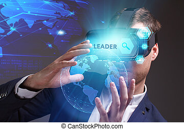 Business, Technology, Internet and network concept. Young businessman working on a virtual screen of the future and sees the inscription: Leader