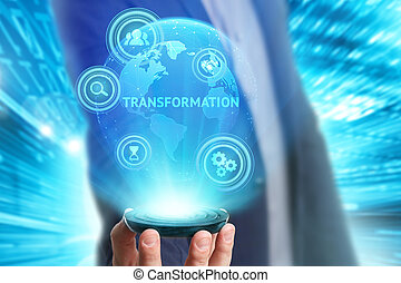 Business, Technology, Internet and network concept. Young businessman working on a virtual screen of the future and sees the inscription: Transformation