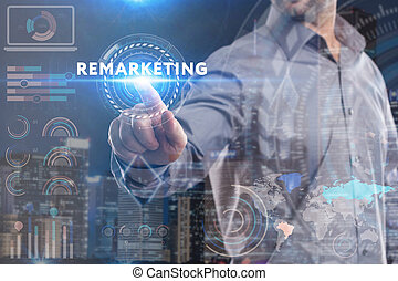 Business, Technology, Internet and network concept. Young businessman working on a virtual screen of the future and sees the inscription: Remarketing