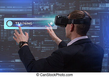 Business, Technology, Internet and network concept. Young businessman working on a virtual screen of the future and sees the inscription: Training