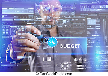 Business, Technology, Internet and network concept. Young businessman working on a virtual screen of the future and sees the inscription: Budget