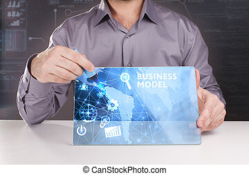 Business, Technology, Internet and network concept. Young businessman working on a virtual screen of the future and sees the inscription: Business model