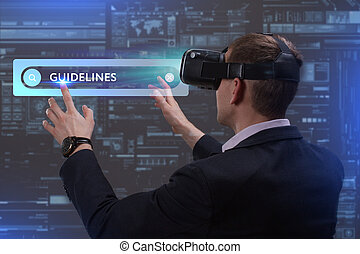 Business, Technology, Internet and network concept. Young businessman working on a virtual screen of the future and sees the inscription: Guidelines