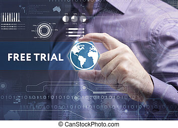 Business, Technology, Internet and network concept. Young businessman working on a virtual screen of the future and sees the inscription: free trial