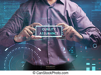 Business, Technology, Internet and network concept. Young businessman working on a virtual screen of the future and sees the inscription: Quality assurance