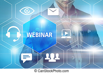 business, technology, internet and networking concept - businessman pressing free webinar button on virtual screens
