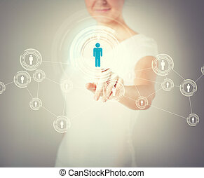 businesswoman pressing button with contact