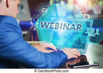 Business, Technology, Internet and networking concept. Young businessman working on his laptop of the future, working with the virtual screen hologram. The inscription on the screen: free webinar.