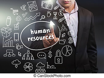 Business, Technology, Internet and network concept. Business man working on the tablet of the future, select on the virtual display: human resources