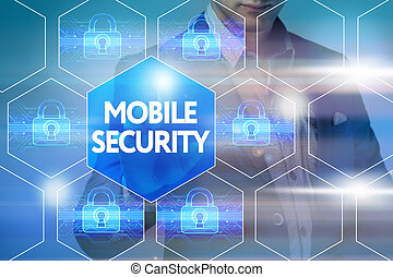 Business, technology, internet and networking concept. Businessman presses a button on the virtual screen: Mobile security