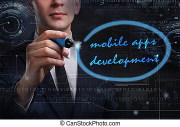 Business, Technology, Internet and network concept. Young business man writing word: mobile apps development
