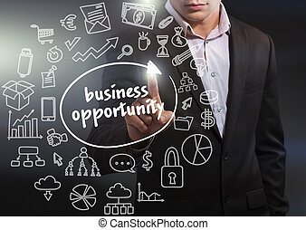Business, Technology, Internet and network concept. Business man working on the tablet of the future, select on the virtual display: business opportunity