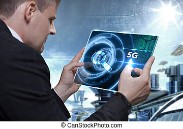 Business, Technology, Internet and network concept. Businessman working on the tablet of the future, select on the virtual display: 5G