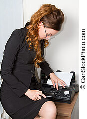 Business theme: beautiful secretary faxing document More of this series on my portfolio