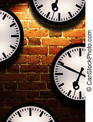 Business Time - Brick wall with light effect and clock