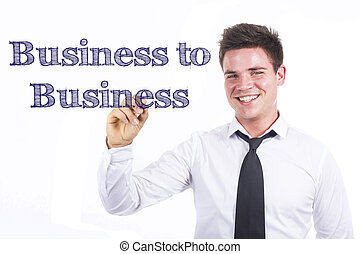 Business to Business - Young smiling businessman writing on transparent surface