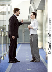 Business together - Businessman and businesswoman having...