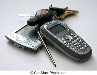 Business tools - Cell phone, PDA, stylus, and keys over...