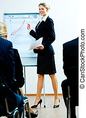 Business training - Image of successful woman teaching a...