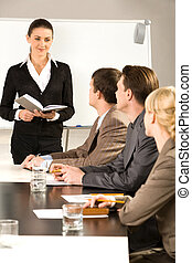 Business training - Image of woman suggesting a new project ...