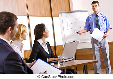 Business training - Business people are discussing a new...